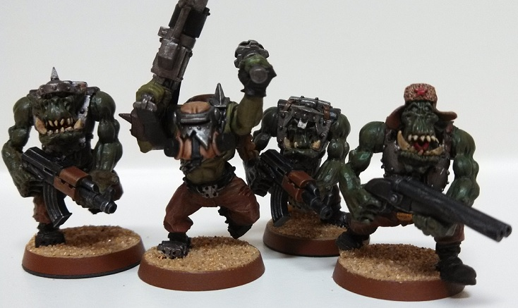 four recently painted orks